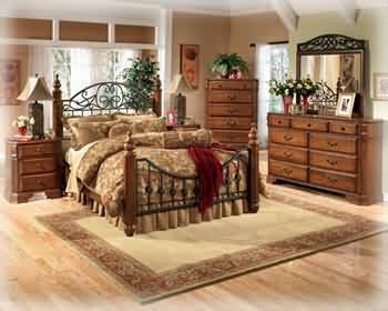Ashley Wyatt Iron Poster Queen Size Bedroom Set in Rich Oak Finish