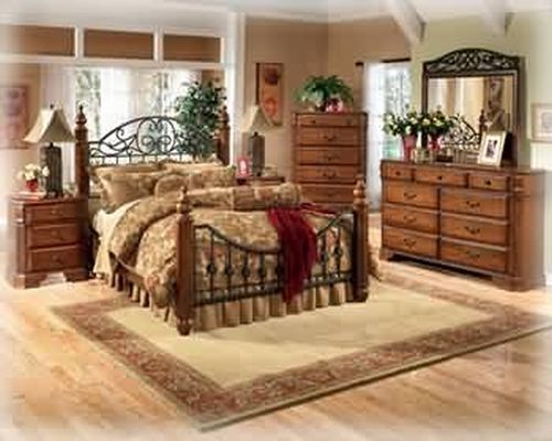 Ashley Wyatt Iron Poster Country Queen Size Bedroom Set in Rich Oak Finish